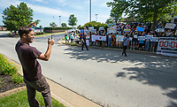 NWA Democrat-Gazette/BEN GOFF @NWABENGOFF<br /> Abel Tomlinson (left), an organizer, takes photos of the crowd of Bernie Sanders supporters gathered Wednesday, June 5, 2019, outside the Walmart shareholders formal business meeting at the John Q. Hammons Center in Rogers.