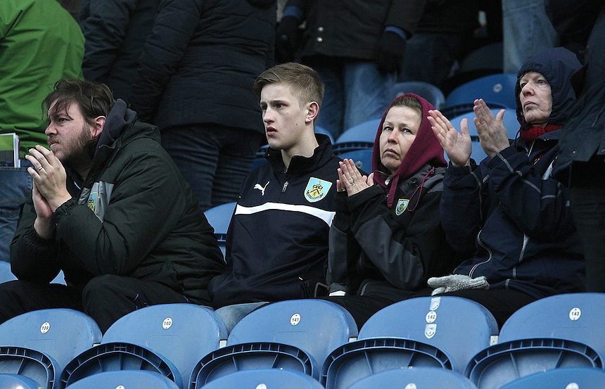 Burnley fans look dejected as they applaud their side following a 1 - 0  defeat<br /> <br /> Photographer Rich Linley/CameraSport<br /> <br /> Football - Barclays Premiership - Burnley v Swansea City - Friday 27th February 2015 - Turf Moor - Burnley<br /> <br /> &copy; CameraSport - 43 Linden Ave. Countesthorpe. Leicester. England. LE8 5PG - Tel: +44 (0) 116 277 4147 - admin@camerasport.com - www.camerasport.com