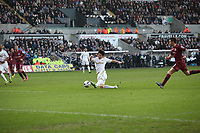 Pictured: Swansea's Ki Sung Yeung with a shot against Newcastle United. <br />
