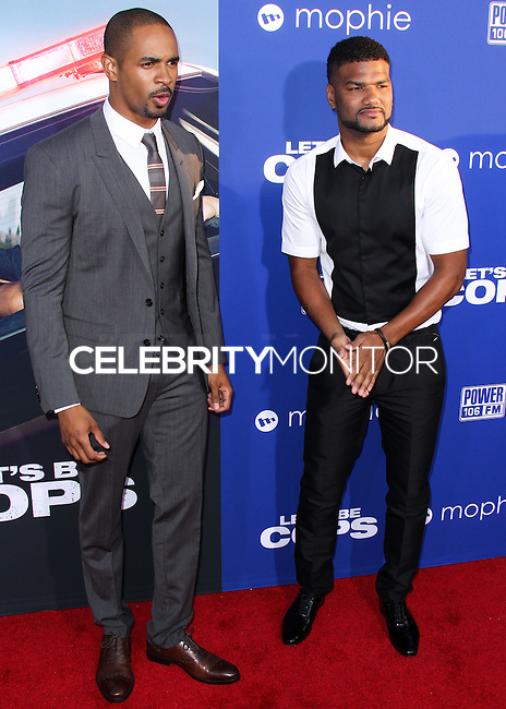 """HOLLYWOOD, LOS ANGELES, CA, USA - AUGUST 07: Damon Wayans Jr., Damien Wayans at the Los Angeles Premiere Of 20th Century Fox's """"Let's Be Cops"""" held at ArcLight Cinemas Cinerama Dome on August 7, 2014 in Hollywood, Los Angeles, California, United States. (Photo by Xavier Collin/Celebrity Monitor)"""