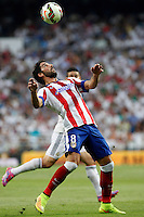 James of Real Madrid and Raul Garcia of Atletico de Madrid during La Liga match between Real Madrid and Atletico de Madrid at Santiago Bernabeu stadium in Madrid, Spain. September 13, 2014. (ALTERPHOTOS/Caro Marin)