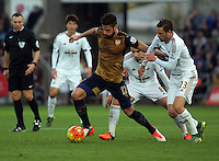 (L-R) Olivier Giroud of Arsenal is held back by Gylfi Sigurdsson of Swansea during the Barclays Premier League match between Swansea City and Arsenal at the Liberty Stadium, Swansea on October 31st 2015
