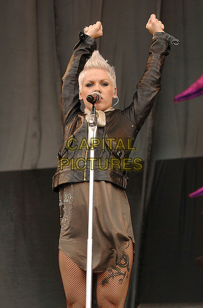 PINK.Performing live at the 2007 V Festival, Hylands Park, Chelmsford, England..August 18th 2007..half 3/4 length stage concert live gig performance music pinnk black leather jacket gold scarf grey gray dress arms in air fishnet tights singing microphone tattoo.CAP/BEL.©Belcher/Capital Pictures
