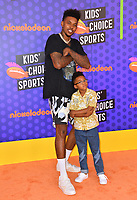 Nick Young &amp; Nick Young Jr. at the Nickelodeon Kids' Choice Sports Awards 2018 at Barker Hangar, Santa Monica, USA 19 July 2018<br /> Picture: Paul Smith/Featureflash/SilverHub 0208 004 5359 sales@silverhubmedia.com