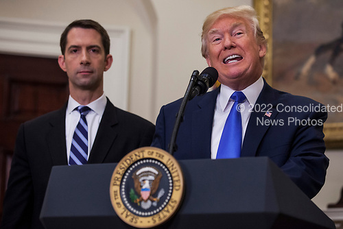 United States President President J. Donald Trump makes an announcement on the introduction of the Reforming American Immigration for a Strong Economy (RAISE) Act with US Senator Tom Cotton (Republican of Arkansas), left,  in the Roosevelt Room at the White House in Washington, D.C., U.S., on Wednesday, August 2, 2017. The act aims to overhaul U.S. immigration by moving towards a &quot;merit-based&quot; system.  <br /> Credit: Zach Gibson / Pool via CNP