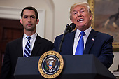 "United States President President J. Donald Trump makes an announcement on the introduction of the Reforming American Immigration for a Strong Economy (RAISE) Act with US Senator Tom Cotton (Republican of Arkansas), left,  in the Roosevelt Room at the White House in Washington, D.C., U.S., on Wednesday, August 2, 2017. The act aims to overhaul U.S. immigration by moving towards a ""merit-based"" system.  <br /> Credit: Zach Gibson / Pool via CNP"