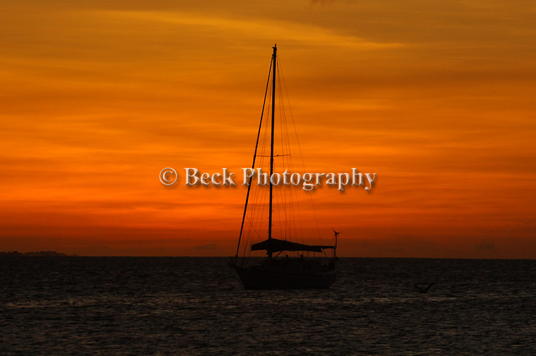 SAILBOAT SILHOUETTE IN THE SUNSET
