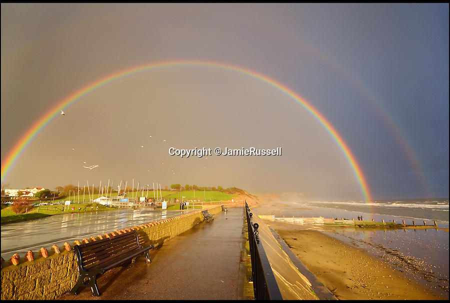 BNPS.co.uk (01202 55883&pound;)<br /> Pic: JamieRussell/BNPS<br /> <br /> ***Please Use Full Byline***<br /> <br /> Yaverland beach, showery evening. <br /> <br /> Stunning photographs have revealed a turbulent side to the normally genteel Isle of Wight.<br /> <br /> The seemingly benign south coast holiday destination has been catalogued over a stormy year by local photographer Jamie Russell, and his astonishing pictures reveal the dramatic changes in weather that roll across the UK in just 12 months.<br /> <br /> Lightning storms, ice, floods, gales and blizzards have all been captured by the intrepid photographer who frequently got up in the middle of the night to capture the climatic chaos.<br /> <br /> Looking at these pictures prospective holidaymakers could be forgiven for thinking twice about a gentle staycation on the south coast island.