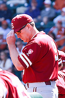AUSTIN, TEXAS-March 6, 2011:  Head Coach Mark Marquess of Stanford gives signs to the hitter during the game against the Texas Longhorns, at Disch-Falk field in Austin, Texas.  Texas defeated Stanford 4-2.