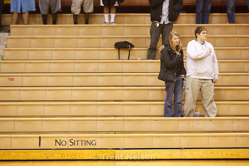 Trent Nelson  |  The Salt Lake Tribune.National anthem, no sitting sign, at Highland vs. Riverton High School basketball in Salt Lake City, Utah, Friday, December 2, 2011.