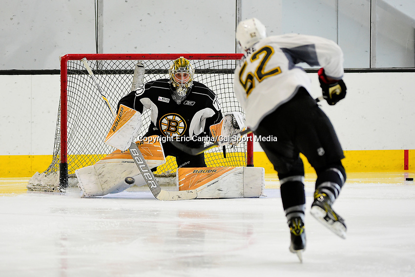 July 7, 2017: Boston Bruins forward Cedric Pare (52) shoots on goalie Dan VlAdar (70) during the Boston Bruins development camp held at Warrior Ice Arena in Brighton, Massachusetts. Eric Canha/CSM