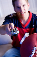 Series with a football fan, isolated on white, and in a room watching television.