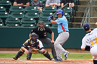 Tennessee Smokies first baseman Anthony Giansanti (9) at bat in front of catcher Justin O'Conner and umpire Alex Ransom during a game against the Montgomery Biscuits on May 25, 2015 at Riverwalk Stadium in Montgomery, Alabama.  Tennessee defeated Montgomery 6-3 as the game was called after eight innings due to rain.  (Mike Janes/Four Seam Images)