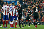 Atletico de Madrid's Jose Maria Gimenez (l) and Bayer 04 Leverkusen's Lars Bender have words in presence of Stefan Kiessling (c) during Champions League 2014/2015 match.March 16,2015. (ALTERPHOTOS/Acero)