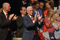 MIAMI, FL - JUNE 16: Florida Gov. Rick Scott, Labor Secretary Alexander Acosta and U.S. Vice President Mike Pence  wait for U.S. President Donald Trump to speak about policy changes he is making toward Cuba at the Manuel Artime Theater in the Little Havana neighborhood on June 16, 2017 in Miami, Florida. The President will re-institute some of the restrictions on travel to Cuba and U.S. business dealings with entities tied to the Cuban military and intelligence services.  Credit: MPI10 / MediaPunch