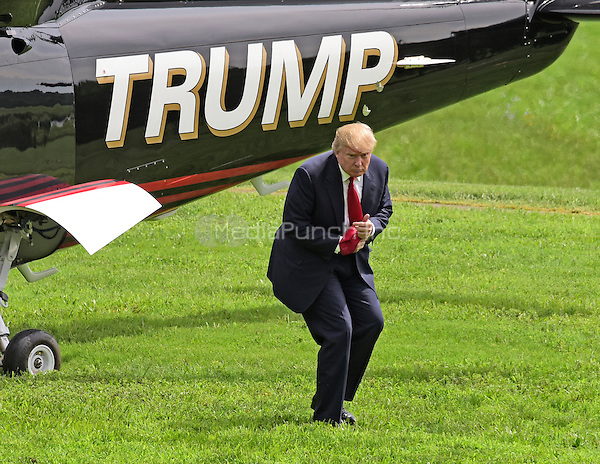 Donald Trump, a candidate for the 2016 Republican nomination for President of the United States, arrives via helicopter at the Albemarle Estate at the Trump Winery in Charlottesville, Virginia on Tuesday, July 14, 2015.   Trump was in Virginia to appear at the ribbon cutting for the new business venture.<br /> Credit: Ron Sachs / CNP/MediaPunch<br /> <br /> (RESTRICTION: NO New York or New Jersey Newspapers or newspapers within a 75 mile radius of New York City)