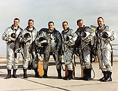 U.S. Air Force X-15 Pilots Group photo taken in 1966 - Left to right: Joseph Engle, Robert Rushworth, Jack McKay, Pete Knight, Milt Thompson, and Bill Dana. This joint program by the National Aeronautics and Space Administration (NASA), the United States Air Force, the United States Navy, and North American Aviation, Inc. operated the most remarkable of all the rocket research aircraft. Composed of an internal structure of titanium and a skin surface of a chrome-nickel alloy known as Inconel X, the X-15 had its first, unpowered glide flight on June 8, 1959, while the first powered flight took place on September 17, 1959. Because of the large fuel consumption of its rocket engine, the X-15 was air launched from a B-52 aircraft at about 45,000 ft and speeds upward of 500 mph. The airplane first set speed records in the Mach 4-6 range with Mach 4.43 on March 7, 1961; Mach 5.27 on June 23, 1961; Mach 6.04 on November 9, 1961; and Mach 6.7 on October 3, 1967. It also set an altitude record of 354,200 feet (67 miles) on August 22, 1963, and provided an enormous wealth of data on hypersonic air flow, aerodynamic heating, control and stability at hypersonic speeds, reaction controls for flight above the atmosphere, piloting techniques for reentry, human factors, and flight instrumentation. The highly successful program contributed to the development of the Mercury, Gemini, and Apollo piloted spaceflight programs as well as the Space Shuttle program. The program's final flight was performed on October 24, 1968.