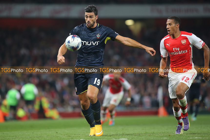 Graziano Pelle of Southampton controls the ball as Arsenal's Isaac Hayden looks on - Arsenal vs Southampton - Capital One Cup Third Round Football at the Emirates Stadium, London - 23/09/14 - MANDATORY CREDIT: Paul Dennis/TGSPHOTO - Self billing applies where appropriate - contact@tgsphoto.co.uk - NO UNPAID USE