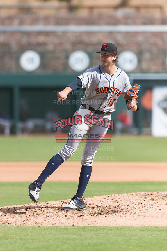 Scottsdale Scorpions starting pitcher Forrest Whitley (11), of the Houston Astros organization, follows through on his delivery during an Arizona Fall League game against the Glendale Desert Dogs at Camelback Ranch on October 16, 2018 in Glendale, Arizona. Scottsdale defeated Glendale 6-1. (Zachary Lucy/Four Seam Images)