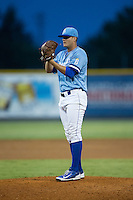 Burlington Royals relief pitcher Chase Darhower (28) looks to his catcher for the sign against the Pulaski Yankees at Burlington Athletic Park on August 6, 2015 in Burlington, North Carolina.  The Royals defeated the Yankees 1-0. (Brian Westerholt/Four Seam Images)