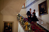 Washington, DC - December 13, 2009 -- United States President Barack Obama and First Lady Michelle Obama descend the Grand Staircase of White House to attend a holiday party, Sunday, December 13, 2009. .Mandatory Credit: Pete Souza - White House via CNP