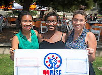 Occidental College students offer information about 99Rise as part of the Community Resource Fair for admitted students and their parents on the Occidental College campus during Experience Oxy! Admitted Student Day, April 18, 2014. (Photo by Marc Campos, Occidental College Photographer)