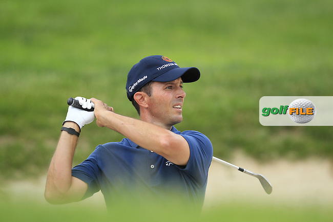 Mike Weir (CAN) plays from a bunker at the 18th green during Thursday's Round 1 of the 113th U.S.Open National Championship held at Merion Golf Club, Ardmore, Philadelphia, Pennsylvania. <br /> 13th June 2013<br /> (Picture: Eoin Clarke www.golffile.ie)