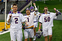 Albany players Kyle Casey (#2), Tehoka Nanticoke (#1) and Sean Gleason (#50) celebrate the victory as UAlbany Men's Lacrosse defeats Richmond 18-9 on May 12 at Casey Stadium in the NCAA tournament first round.