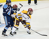 Ryan Hegarty (Maine - 44), Travis Oleksuk (Duluth - 11) - The University of Minnesota Duluth Bulldogs defeated the University of Maine Black Bears 5-2 in their NCAA Northeast semifinal on Saturday, March 24, 2012, at the DCU Center in Worcester, Massachusetts.