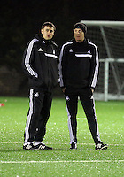 Swansea manager Garry Monk (R) during training