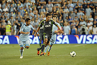 Leonardo Gonzalez (12) defender Seattle Sounders moves the ball upfield..Sporting Kansas City defeated Seattle Sounders on penalty kicks, after a 1-1 tied game to win the Lamar Hunt Open Cup at LIVESTRONG Sporting Park, Kansas City, Kansas..