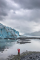 Tourist takes a picture of Bryn Mawr glacier in College Fjord, Chugach National Forest, Prince William Sound, Alaska.