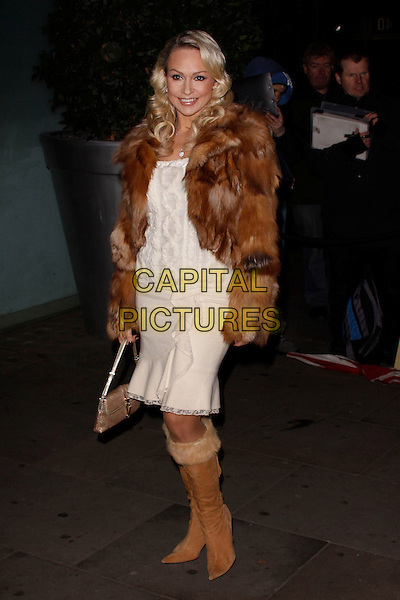 Kristina Rihanoff.English National Ballet's 'The Nutcracker', St Martins Lane Hotel and The London Coliseum, London, England. .December 13th, 2012.full length brown boots fur coat jacket white dress .CAP/AH.©Adam Houghton/Capital Pictures.