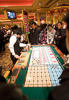 Gamblers play Sic Bo in Venetian casino, in Macao, China, on December 17, 2009. Photo by Lucas Schifres/Pictobank