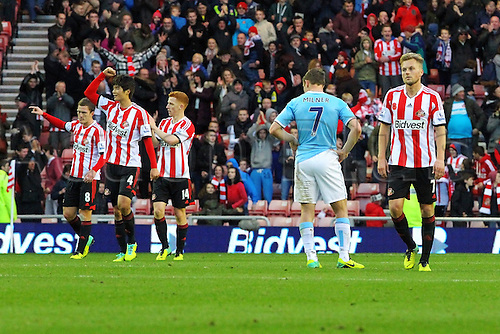 10.11.2013 Sunderland, England. James Milner of Manchester City looks on dejected as Sunderland celebrate their win during the Premier League game between Sunderland and Manchester City from the Stadium of Light.