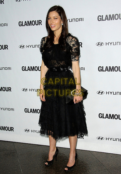 JESSICA BIEL.The Glamour Reel Moments Presented by Hyundai held at The Directors Guild of America in West Hollywood, California, USA..October 25th 2010.full length black lace dress ruffles ruffle tiered see thru through sheer shoes heels peep toe bar belt clutch bag  .CAP/ADM/TC.©T. Conrad/AdMedia/Capital Pictures.