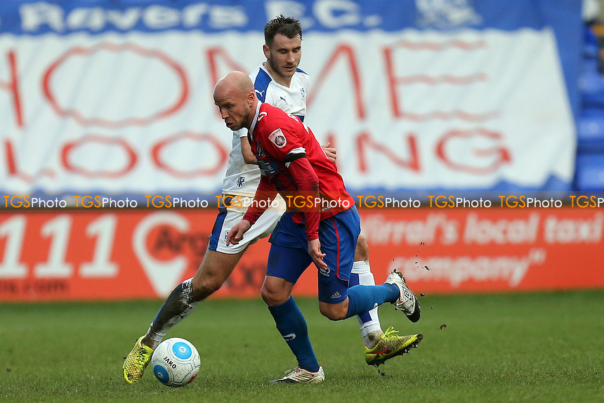 Luke Guttridge of Dagenham and James Wallace of Tranmere Rovers during Tranmere Rovers vs Dagenham & Redbridge, Vanarama National League Football at Prenton Park on 28th January 2017