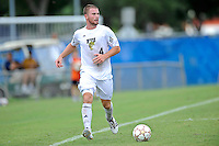 2 October 2011:  FIU defender Joseph Dawkins (4) moves the ball upfield in the second half as the FIU Golden Panthers defeated the University of Kentucky Wildcats, 1-0 in overtime, at University Park Stadium in Miami, Florida.