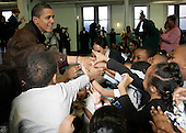 Chicago, IL - November 26, 2008 -- United States President-elect Barack Obama shakes hands with children attending St. Columbanus Parrish and School Wednesday, November 26, 2008, in Chicago, Illinois. .Credit: Frank Polich - Pool via CNP
