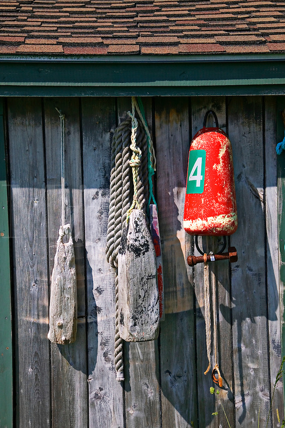 Fishing equiptment, fishng gear on old shack, Nova Scotia; Canada