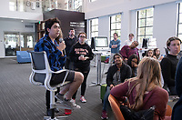 """Students, faculty and staff gather on Wednesday, May 8, 2019 in the Global Forum and Varelas Innovation Lab in Johnson Hall for a celebration of student research from Spring 2019 courses, with projects utilizing Scalar, 360 video and drone photography, virtual reality, audio recordings, and more: ARTH180 """"Introduction to Later European Art""""; ARTH390 """"Building the American Pacific""""; CSP70 """"Countercultural Northeast LA: The Arts of Resistance""""; CTSJ 337 """"Queer Los Angeles: Cruising the Archive""""; CSLC233/RUSN333 """"Codes, Cultures, & Killing""""; HIST355 """"Indians of Mexico.<br /> (Photo by Marc Campos, Occidental College Photographer)"""