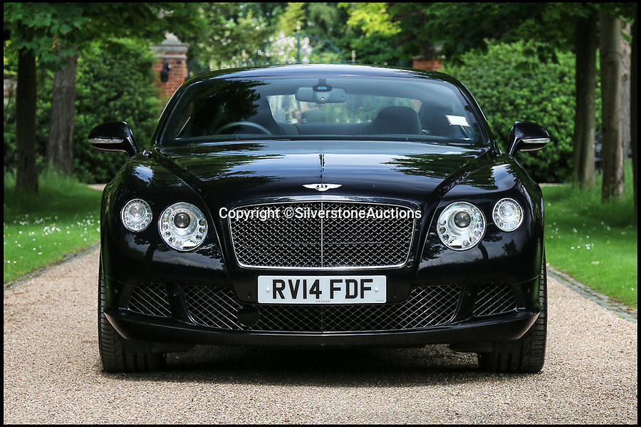 BNPS.co.uk (01202 558833)Pic: SilverstoneAuctions/BNPS<br /> <br /> Elton John's 2014 Continental GT Speed Bentley is up for sale for £80,000.<br /> <br /> A stunning Bentley belonging to Sir Elton John has emerged for sale at auction with experts tipping it to make up to £80,000.<br /> <br /> The 2014 Continental GT Speed is being sold by the legendary musician three years after he gifted it to his husband, David Furnish.<br /> <br /> Previously the Circle of Life singer had been using the car as his own personal vehicle after purchasing it new in June 2014.<br /> <br /> The world-famous pair have used the stunning black car regularly in their years of ownership and have covered around 22,000 miles.<br /> <br /> Now however one lucky punter will have the chance to drive it away up the yellow brick road as the pair have decided to part with the luxurious vehicle.