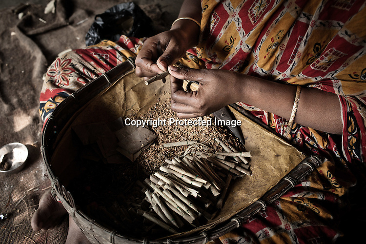 A woman from the Chowduli class is seen making bidi in her house in Chaymalpur village of North 24 Parganas in West Bengal, India. Photo: Sanjit Das/Panos for The Wall Street Journal. Slug: ICASTE