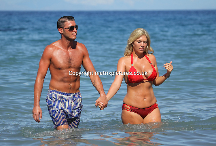 EXCLUSIVE PICTURE: TREVOR ADAMS / MATRIXPICTURES.CO.UK<br /> PLEASE CREDIT ALL USES<br /> <br /> WORLD RIGHTS<br /> <br /> English ex TOWIE reality TV star Frankie Essex and her boyfriend John Lyons can't seem to keep their hands off each other during a dip in the ocean while on holiday in Greece. <br /> <br /> Frankie has just been named as the new face of Exante Diet and plans to show how she can loose three stone over the next three months.<br /> <br /> APRIL 5th 2014<br /> <br /> REF: UPR 136498