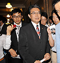 June 26, 2012, Tokyo, Japan : Member of the House of Representatives Hiroshi Kawauchi speaks to Journalist after the lower house plenary session at the Parliament in Tokyo, Japan, on June 26, 2012.