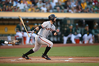 OAKLAND, CA - JULY 31:  Brandon Belt #9 of the San Francisco Giants bats against the Oakland Athletics during the game at the Oakland Coliseum on Monday, July 31, 2017 in Oakland, California. (Photo by Brad Mangin)
