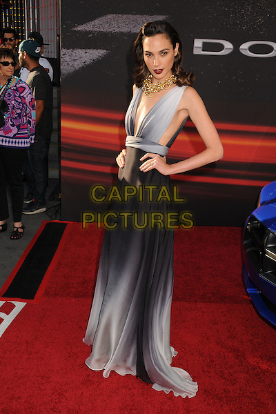 "Gal Gadot.""Fast & Furious 6"" Los Angeles Premiere held at the Universal Gibson Amphitheatre, Universal City, California, USA..May 21st, 2013.full length black grey gray dress slit split sleeveless hands on hips.CAP/ADM/BP.©Byron Purvis/AdMedia/Capital Pictures"
