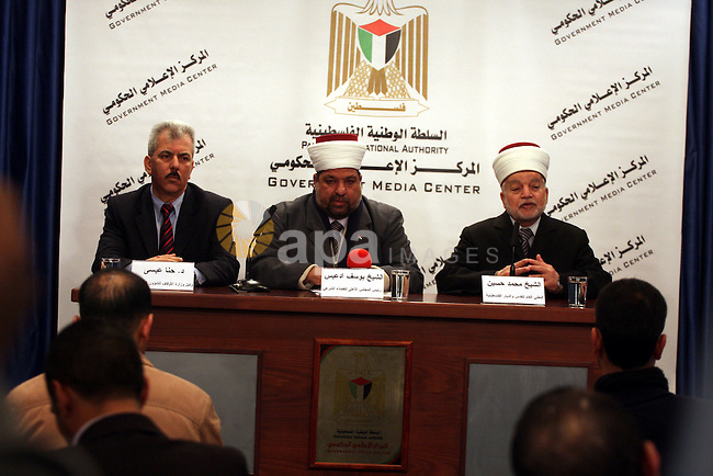 Yousuf Adaies, the head of the Supreme Council of the legitimate judical, Mohammed Hussein, the mufti of Jerusalem and Palestine and Hanna Issa, the Minister of the Endowments for Christian affairs attends a joint news conference in Ramallah in the West Bank, February 16, 2011. Photo by Issam Rimawi