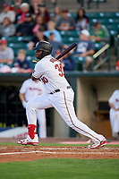 Rochester Red Wings first baseman Kennys Vargas (30) follows through on a swing during a game against the Pawtucket Red Sox on May 19, 2018 at Frontier Field in Rochester, New York.  Rochester defeated Pawtucket 2-1.  (Mike Janes/Four Seam Images)
