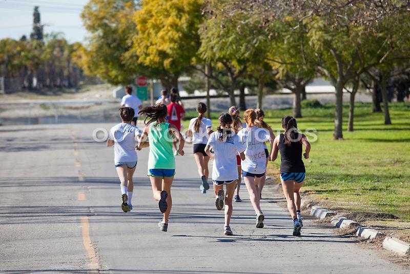 Teens Running Through El Dorado Regional Park In Long Beach California